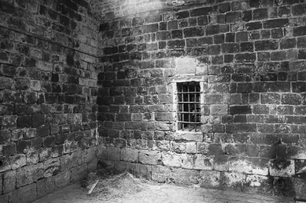 A jail with a grated window.