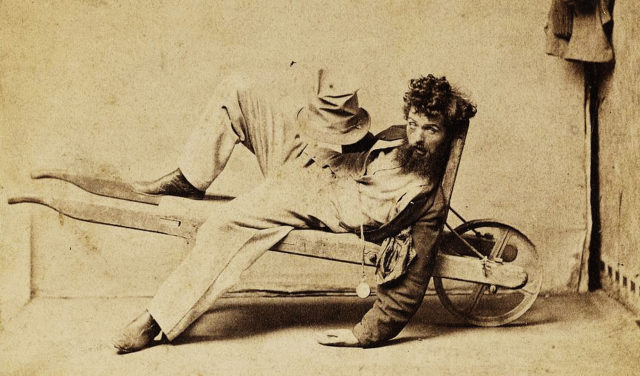 A drunk tramp with a pocket watch.